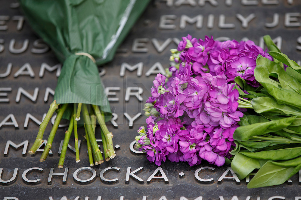 © Licensed to London News Pictures. 06/07/2015. London, UK. Flowers left for the victims at 7 July Memorial in Hyde Park to commemorate the 10th anniversary of 7/7 London bombings on Monday, July 6, 2015. Photo credit: Tolga Akmen/LNP