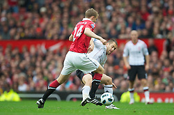 MANCHESTER, ENGLAND - Sunday, September 19, 2010: Liverpool's Joe Cole and Manchester United's Darren Fletcher during the Premiership match at Old Trafford. (Photo by David Rawcliffe/Propaganda)