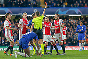 RED CARD Ajax defender Daley Blind (17) fouls Chelsea forward Tammy Abraham (9) during the Champions League match between Chelsea and Ajax at Stamford Bridge, London, England on 5 November 2019.