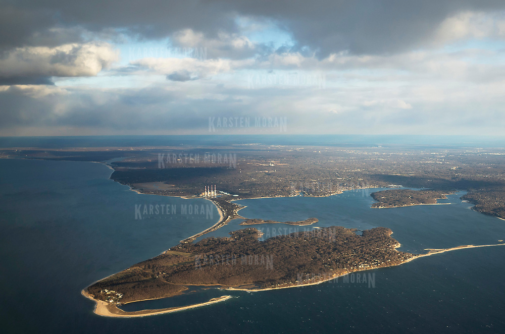 April 8, 2018 - Long Island, NY : Huntington and Northport Bays, the Northport Power Station, Eatons Neck, in the foreground, and the northern shore of Long Island and Long Island Sound are seen from the air on Sunday evening, April 8. CREDIT: Karsten Moran / REDUX