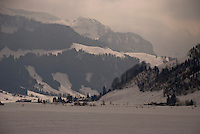The mountains above Studen, Switzerland, on a dark, wintry day.