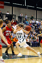 10 January 2009:  Claire Sheehan drives into the lane that id guarded by Shana Lieberman. The Illinois Wesleyan Titans, ranked #1 in the latest USA Today/ESPN poll, take down the Lady Reds of Carthage and remain undefeated,  2-0 in the CCIW and over all to 12-0. This is the first time in the history of the Lady Titans Basketball they have been ranked #1 The Titans and Lady Reds played in the Shirk Center on the Illinois Wesleyan Campus in Bloomington Illinois.