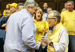 Jan 20, 2018; Morgantown, WV, USA; West Virginia University president Gordon Gee talks with David Alvarez before the start of the game against the Texas Longhorns at WVU Coliseum. Mandatory Credit: Ben Queen-USA TODAY Sports