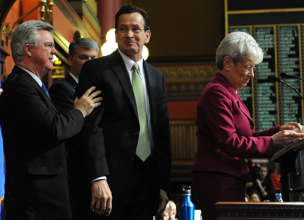 Connecticut Gov. Dannel P. Malloy, center, reacts as he is being introduced by Lt. Gov. Nancy Wyman, right, as Speaker of the House Christopher Donavan, D-Merident, left, looks on, before presenting his first two-year budget, during a joint session of the General Assembly at the Capitol, in Hartford, Conn., Wednesday, Feb. 16, 2011.  The plan raises taxes across-the-board, seeks $2 billion in savings from state employees and attempts to cut spending without stripping programs for the needy. (AP Photo/Jessica Hill).