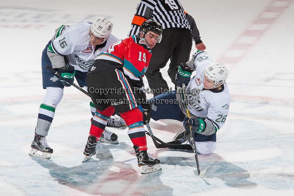 KELOWNA, CANADA - DECEMBER 7: Alexander True #16 and Nolan Volcan #26 of the Seattle Thunderbirds check Dillon Dube #19 of the Kelowna Rockets on December 7, 2016 at Prospera Place in Kelowna, British Columbia, Canada.  (Photo by Marissa Baecker/Shoot the Breeze)  *** Local Caption ***