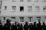 Germany, Frankfurt am Main : A man looks down from his window during a demonstration on the opening day of the European Central Bank (ECB) in Frankfurt am Main, western Germany, on March 18, 2015<br /> <br /> .