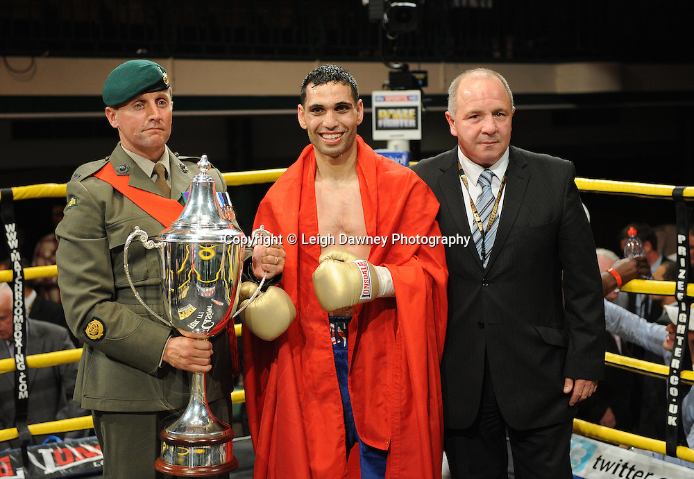 Yassine El Maachi (pictured) is presented trophy by member of the Armed Forces after defeating Junior Witter in the final to claim the title of Prizefighter Welterweights II,York Hall, Bethnal Green ,London. 07.06.11. Matchroom Sport/Prizefighter.Photo credit: Leigh Dawney 2011