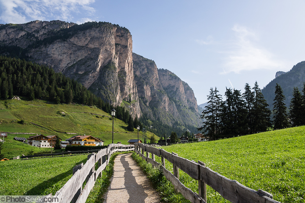 Vallunga/Langental valley, Puez-Geisler Nature Park, Val Gardena, Dolomites, South Tyrol, Italy, Europe. The beautiful ski resort of Selva di Val Gardena (German: Wolkenstein in Gröden; Ladin: Sëlva Gherdëine) makes a great hiking base in the Dolomites, in the South Tyrol region (Trentino-Alto Adige/Südtirol) of Italy, Europe. For our favorite hike in the Dolomiti, start from Selva with the first morning bus to Ortisei, take the Seceda lift, admire great views up at the cross on the edge of Val di Funes (Villnöss), then walk 12 miles (2000 feet up, 5000 feet down) via the steep pass Furcela Forces De Sieles (Forcella Forces de Sielles) to beautiful Vallunga (trail #2 to 16), finishing where you started in Selva. The hike traverses the Geisler/Odle and Puez Groups from verdant pastures to alpine wonders, all preserved in a vast Nature Park: Parco Naturale Puez-Odle (German: Naturpark Puez-Geisler; Ladin: Parch Natural Pöz-Odles). UNESCO honored the Dolomites as a natural World Heritage Site in 2009.