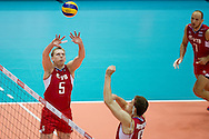 (L) Sergey Apalikov from Russia in action during the 2013 CEV VELUX Volleyball European Championship match between Russia v Slovakia at Ergo Arena in Gdansk on September 24, 2013.<br /> <br /> Poland, Gdansk, September 24, 2013<br /> <br /> Picture also available in RAW (NEF) or TIFF format on special request.<br /> <br /> For editorial use only. Any commercial or promotional use requires permission.<br /> <br /> Mandatory credit:<br /> Photo by © Adam Nurkiewicz / Mediasport