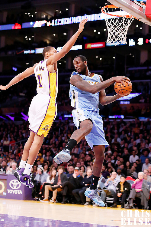 05 January 2014: Denver Nuggets power forward J.J. Hickson (7) looks to pass the ball while in the air over Los Angeles Lakers shooting guard Wesley Johnson (11) during the Denver Nuggets  137-115 victory over the Los Angeles Lakers at the Staples Center, Los Angeles, California, USA.