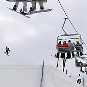 A snowboarder in action during the Billabong Slope-Style 2011 at Snowpark, Wanaka, New Zealand. 5th August 2011