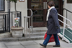 © licensed to London News Pictures. London, UK 13/12/2012. People looking at the flowers which left outside King Edward VII hospital for Jacintha Saldanha, the nurse who apparently took her own life after being duped by two Australian DJ hoax callers. Photo credit: Tolga Akmen/LNP