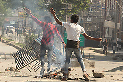 May 5, 2018 - Srinagar, Jammu and Kashmir, India - Protesters clash with Indian police in Srinagar the summer of Indian controlled Kashmir on May 05, 2018. Four people including a protester and three rebels were killed during a gun-battle between rebels and Indian forces in Chattabal area of Srinagar. Massive clashes erupt across Srinagar after the news about the trapping of rebels and killing of protester spread across the city. Police fired teargas canisters, pellets, stun grenades and rubber coated bullets to disperse the angry crowd. (Credit Image: © Faisal Khan/Pacific Press via ZUMA Wire)
