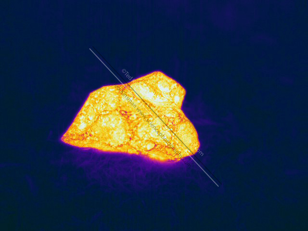 Thermogram of a meteorite.  The warm meteorite is highly visible due to the difference in temperature.  The different colors represent different temperatures on the object. The lightest colors are the hottest temperatures, while the darker colors represent a cooler temperature.  Thermography uses special cameras that can detect light in the far-infrared range of the electromagnetic spectrum (900?14,000 nanometers or 0.9?14 µm) and creates an  image of the objects temperature..