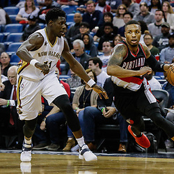 Mar 14, 2017; New Orleans, LA, USA; Portland Trail Blazers guard Damian Lillard (0) drives past New Orleans Pelicans guard Jrue Holiday (11) during the second half of a game at the Smoothie King Center. The Pelicans defeated the Trail Blazers 100-77. Mandatory Credit: Derick E. Hingle-USA TODAY Sports