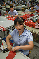 Young Chinese woman at work in the Yingdak leather factory.