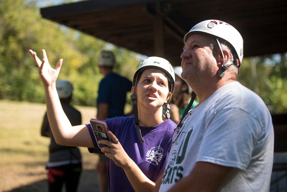 Helen and Bill Stec watch people zipline on Sept. 30, 2018 at the Challenge Course at The Ridges. Photo by Hannah Ruhoff