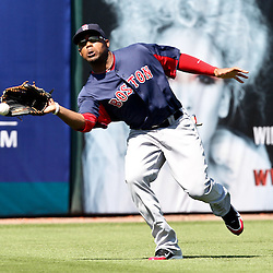 March 11, 2011; Fort Myers, FL, USA; Boston Red Sox left fielder Carl Crawford (13) mis-judges a fly ball during a spring training exhibition game against the Minnesota Twins at Hammond Stadium.  Mandatory Credit: Derick E. Hingle-US PRESSWIRE