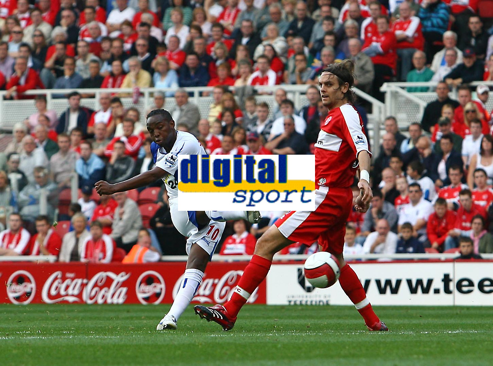 Photo: Andrew Unwin.<br />Middlesbrough v Blackburn Rovers. The Barclays Premiership. 23/09/2006.<br />Middlesbrough's Jonathan Woodgate (R) fails to block a shot from Blackburn's Benni McCarthy (L).