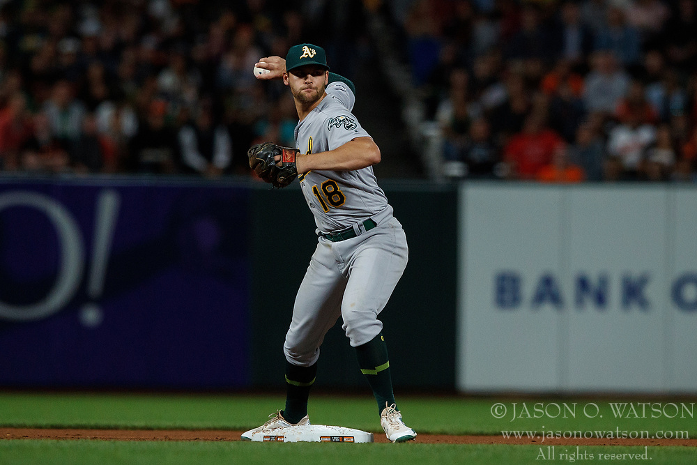 SAN FRANCISCO, CA - AUGUST 13: Chad Pinder #18 of the Oakland Athletics throws to first base to complete a double play during the eighth inning against the San Francisco Giants at Oracle Park on August 13, 2019 in San Francisco, California. The San Francisco Giants defeated the Oakland Athletics 3-2. (Photo by Jason O. Watson/Getty Images) *** Local Caption *** Chad Pinder