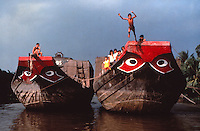kids jump from a boat in the Mekong-Vietnam