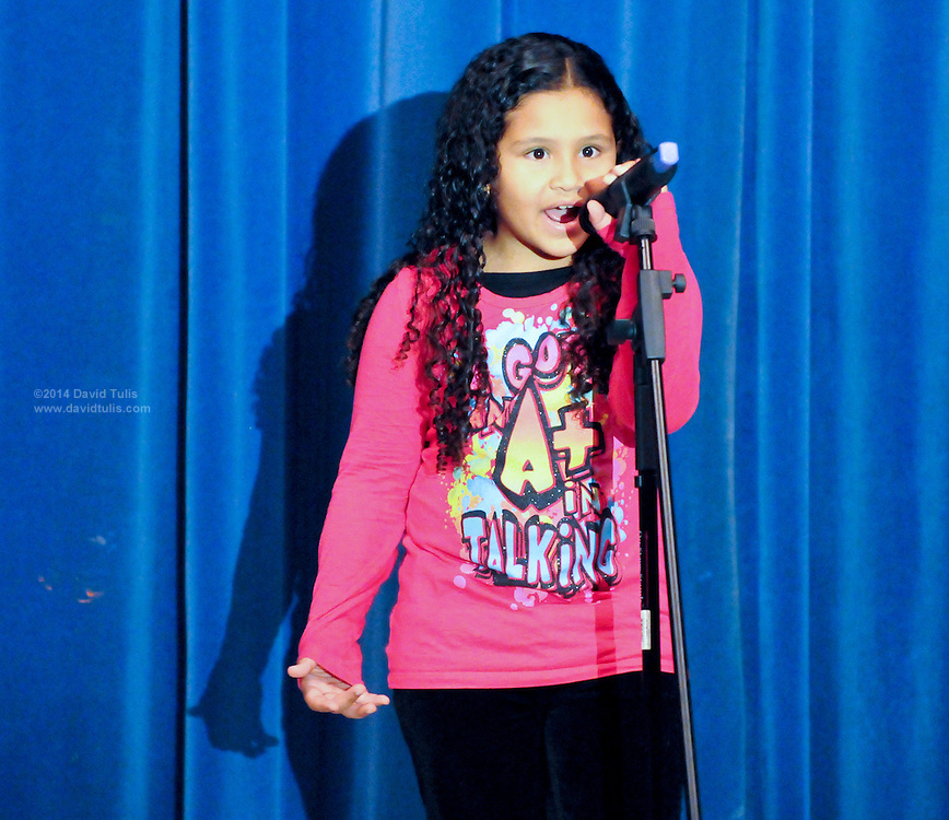 "10/23/09  -  Atlanta, Ga :  Students at Sagamore Hills Elementary School including Angela Sablon with ""Best of Both Worlds"" perform their skits during the 2009 talent show featuring dance, music, comedy and other performances for the annual Showcase of Stars on Friday, October 23, 2009. Director Nancy Briggs, and assistant directors Joe Scivicque and Teresa Libbey helped produce more than 30 acts.    David Tulis         dtulis@gmail.com    ©David Tulis 2009"