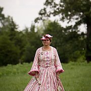 Gari Griffin, of Birmingham, AL, watches the reenactment of Pickett's Charge from a distance in her period dress, during the Sesquicentennial Anniversary of the Battle of Gettysburg, Pennsylvania on Sunday, June 30, 2013.  She and her friend decided to participate as a civilian reenactor for the first time this year.  John Boal photography