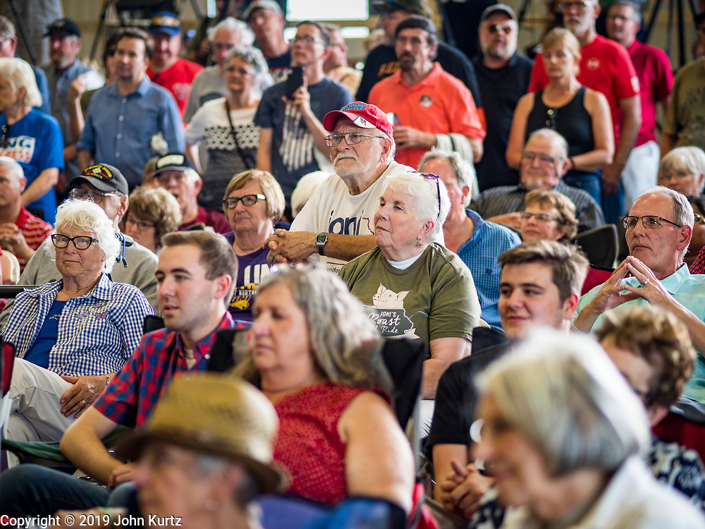 """15 JUNE 2019 - BOONE, IOWA: People listen to a speech by Senator Chuck Grassley (R-IA) during """"Joni's Roast and Ride,"""" an annual motorcycle ride / barbecue fund raiser hosted by Sen. Joni Ernst. Ernst, Iowa's junior US Senator, kicked off her re-election campaign during the """"Roast and Ride"""", an annual fund raiser and campaign event has she held since originally being elected to the US Senate in 2014.  PHOTO BY JACK KURTZ"""