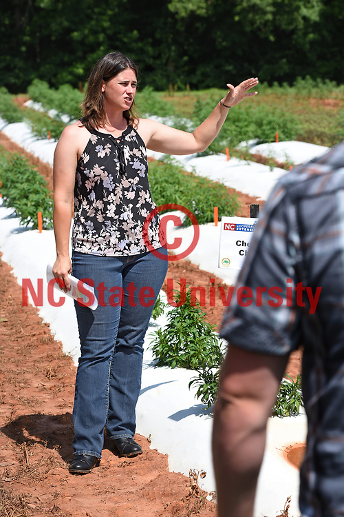Small grains extension specialist Dr. Angela Post talks about industrial hemp during a law enforcement tour at the Piedmont Research Station.