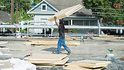 Construction crews work on the roof of the Rusk School, August 22, 2014.