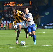 Uche Ikpeazu and \Chris Hussey tussle for the ball during the Sky Bet League 1 match between Bury and Port Vale at Gigg Lane, Bury, England on 19 September 2015. Photo by Mark Pollitt.