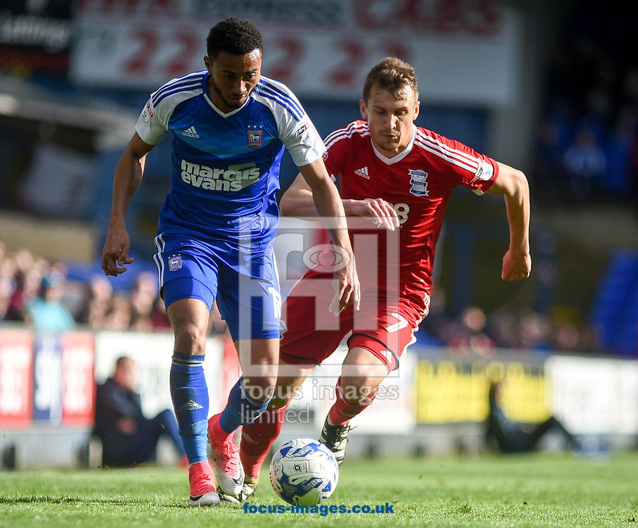 Grant Ward of Ipswich Town and Robert Tesche of Birmingham City battle for the ball during the Sky Bet Championship match at Portman Road, Ipswich<br /> Picture by Hannah Fountain/Focus Images Ltd 07814482222<br /> 01/04/2017
