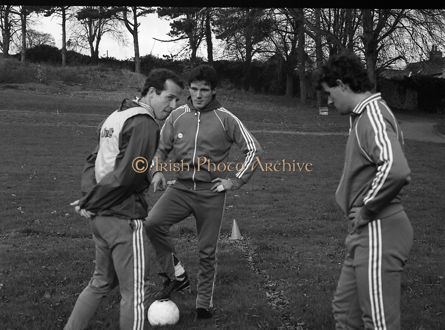 Ireland Soccer Team Training.1983.14.11.1983.11.14.1983.14th November 1983..The Ireland Soccer team trained, for the forthcoming match against Malta, at Stewarts Hospital,Palmerstown Dublin..Picture shows Liam Brady,Frank Stapleton and Kevin Moran at the beginning of the warm up..The game against Malta was played at Lansdowne Road,Dublin.Ireland ran out 8 nil winners.