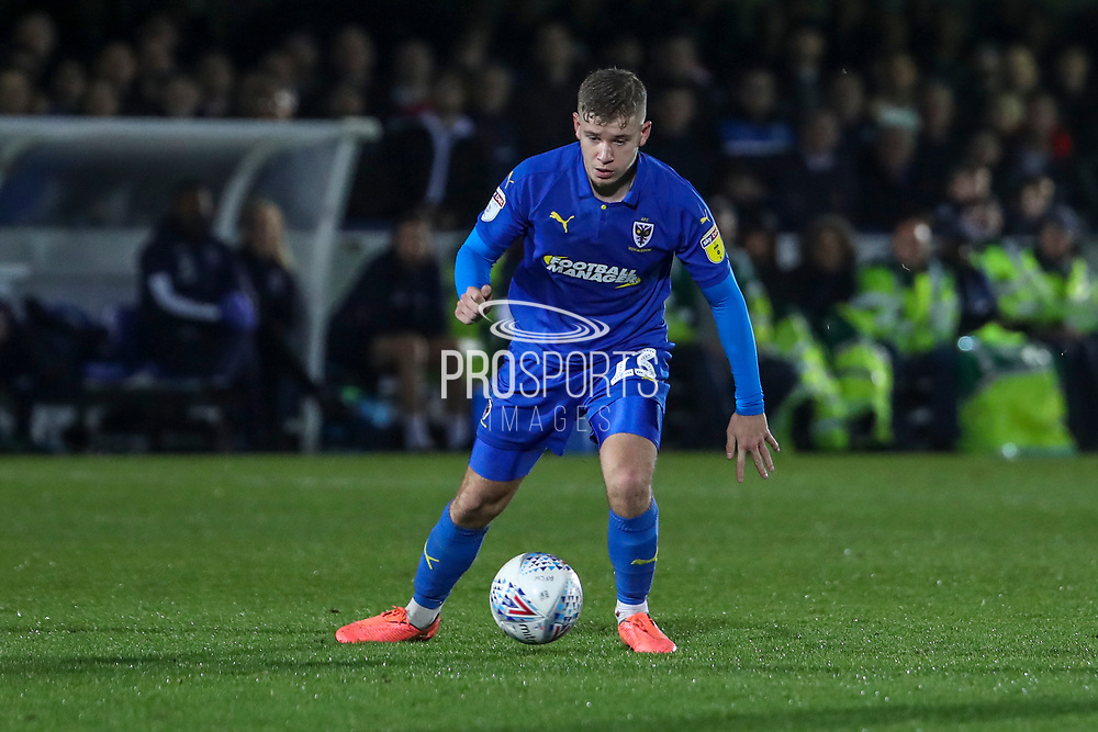 AFC Wimbledon midfielder Max Sanders (23) dribbling during the EFL Sky Bet League 1 match between AFC Wimbledon and Gillingham at the Cherry Red Records Stadium, Kingston, England on 23 November 2019.