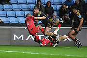 Wasps back row Brad Shields(6) runs into Saracens wing Rotimi Segun (14) during the Gallagher Premiership Rugby match between Wasps and Saracens at the Ricoh Arena, Coventry, England on 21 February 2020.