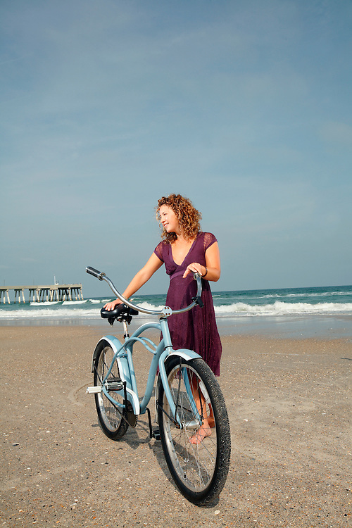 Sasha B. rides her bike on the beach.