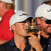 Ryder Cup 2016. Day Three. Jordan Spieth kisses the Ryder Cup as the United States team celebrate their  Ryder Cup win after the United States victory over Europe in the Ryder Cup tournament at Hazeltine National Golf Club on October 02, 2016 in Chaska, Minnesota.  (Photo by Tim Clayton/Corbis via Getty Images)