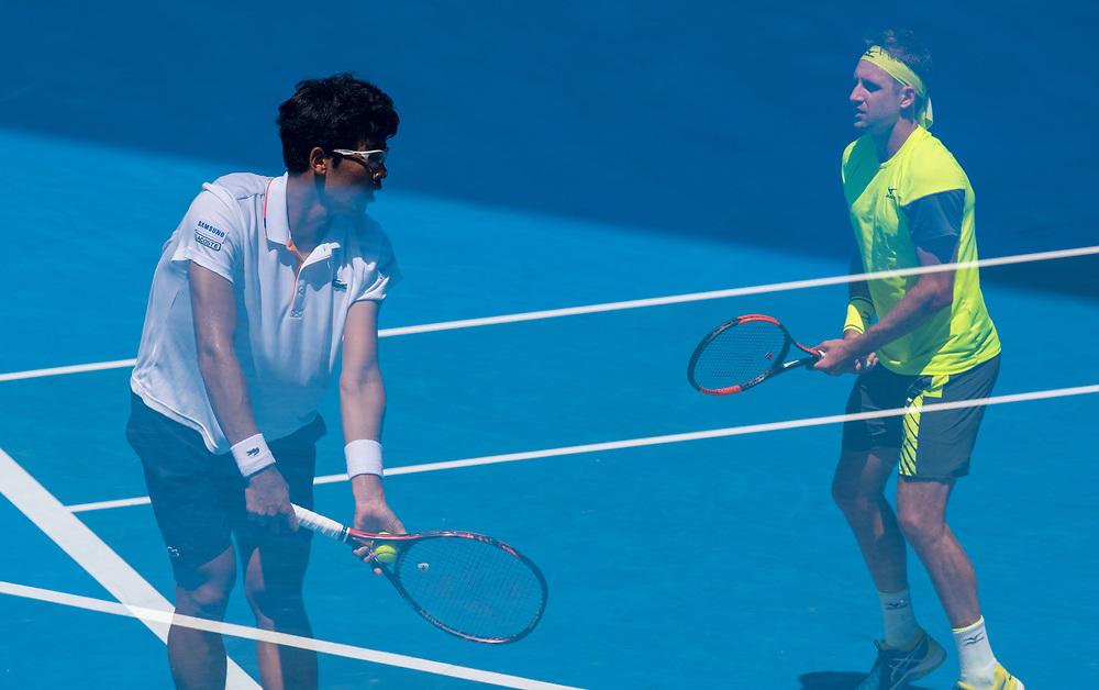 Tennys Sandgren of the United States and Hyeon Chung on South Korea on day ten of the 2018 Australian Open in Melbourne Australia on Wednesday January 24, 2018.<br /> (Ben Solomon/Tennis Australia)