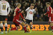 Cardiff City defender Matthew Connolly and Derby County midfielder Craig Bryson come battle it out during the Sky Bet Championship match between Derby County and Cardiff City at the iPro Stadium, Derby, England on 21 November 2015. Photo by Aaron Lupton.