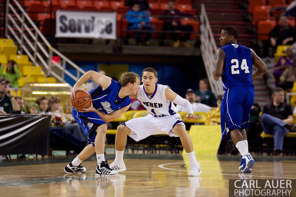 November 27th, 2010:  Anchorage, Alaska - Drake Bulldog Ryan Wedel (10) protects the ball from Weber State sophomore Scott Bamforth (4) in the 81-82 Drake loss to Weber State in the third place game at the Great Alaska Shootout.
