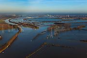 Nederland, Limburg, Gemeente Maasgouw, 10-01-2011; hoogwater Maas, omgeving Maasbracht als gevolg van sneeuwsmelt en neerslag in de bovenloop van de rivier. De stuw bij Linne is gestreken, de overlaat is in werking. Maasbracht area, high water due to snow melt and precipitation upstream. The weir at Linne is lowered, the spillway is in operation..luchtfoto (toeslag), aerial photo (additional fee required).© foto/photo Siebe Swart