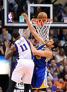Apr 5, 2013; Phoenix, AZ, USA; Phoenix Suns forward Markieff Morris (11) dunks  the ball over the Golden State Warriors center Andrew Bogut (12) in the first half at US Airways Center. The Warriors defeated the Suns 111-107. Mandatory Credit: Jennifer Stewart-USA TODAY Sports