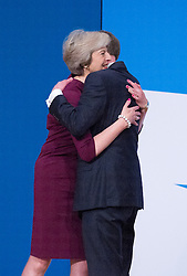 Prime Minister Theresa May welcomes husband Philip John May to the stage after the end of her main speech to delegates in the final day of the Conservative party conference at the International Convention Centre, ICC, Birmingham. Wednesday October 5, 2016. Photo credit should read: Isabel Infantes / EMPICS Entertainment.