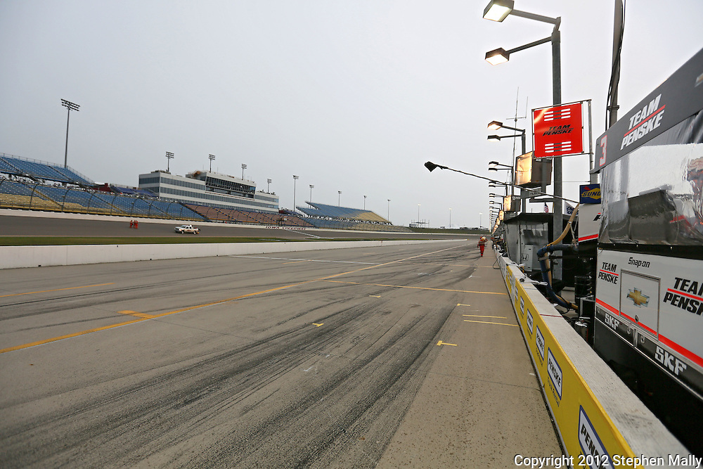 Pit road is empty as rain falls before the start of the IZOD IndyCar Iowa Corn Indy 250 auto race at the Iowa Speedway in Newton, Iowa on Saturday, June 23, 2012.
