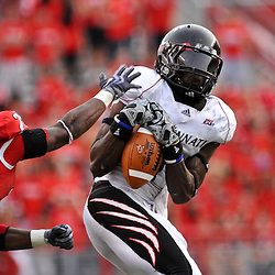 Sep 7, 2009; Piscataway, NJ, USA; Rutgers cornerback Brandon Bing (23) breaks up a pass intended for Cincinnati wide receiver Marshwan Gilyard (1) during the second half as Cincinnati defeats Rutgers 47-15 in NCAA Big East college football at Rutgers Stadium.
