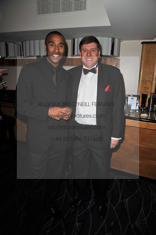 Left to right, COLIN JACKSON and GEOFF COUSINS Managing Director Jaguar U at Quintessentially's 10th birthday party held at The Savoy Hotel, London on 13th December 2010.