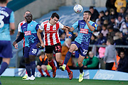 Luke O'Nien of Sunderland heads the ball under pressure from Nick Freeman of Wycombe Wanderers during the EFL Sky Bet League 1 match between Wycombe Wanderers and Sunderland at Adams Park, High Wycombe, England on 19 October 2019.