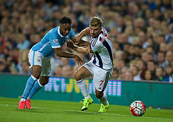 WEST BROMWICH, ENGLAND - Monday, August 10, 2015: Manchester City's Raheem Sterling in action against West Bromwich Albion's James Morrison during the Premier League match at the Hawthorns. (Pic by David Rawcliffe/Propaganda)