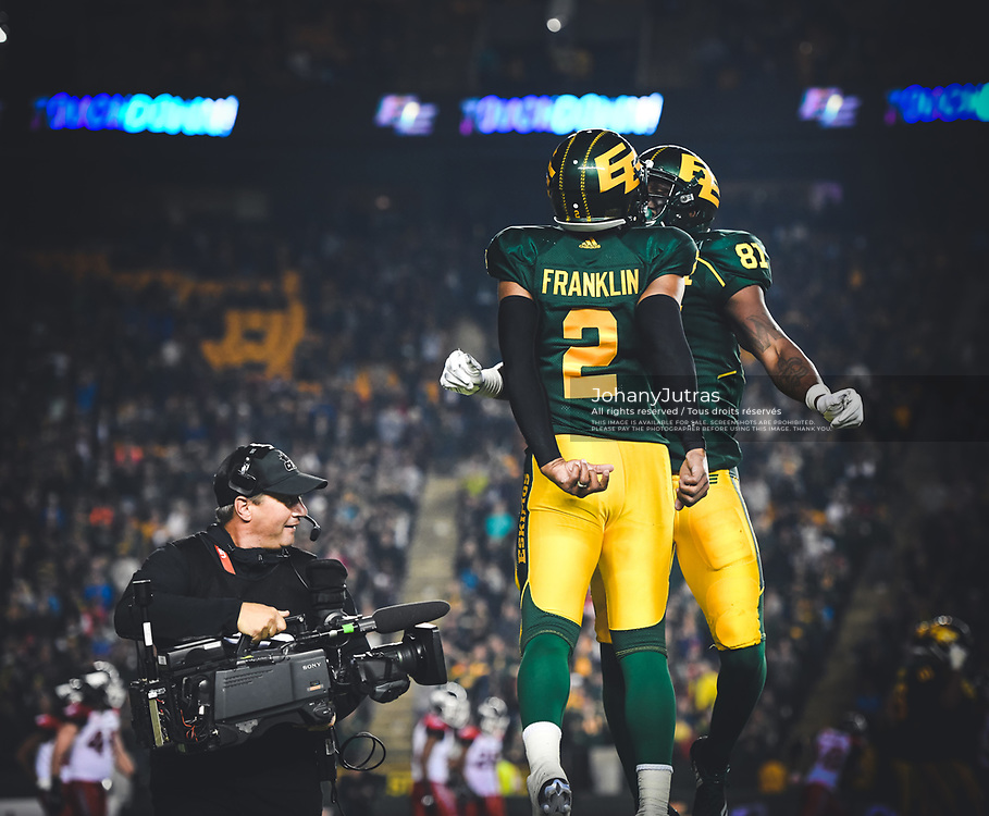 TSN camera operator Phil Laplante Jr. records some on-field live celebration from James Franklin (2) and D'haquille Williams (81) of the Edmonton Eskimos during the game against the Calgary Stampeders at Commonwealth Stadium in Edmonton AB, Saturday, September 9, 2017. (Photo: Johany Jutras)