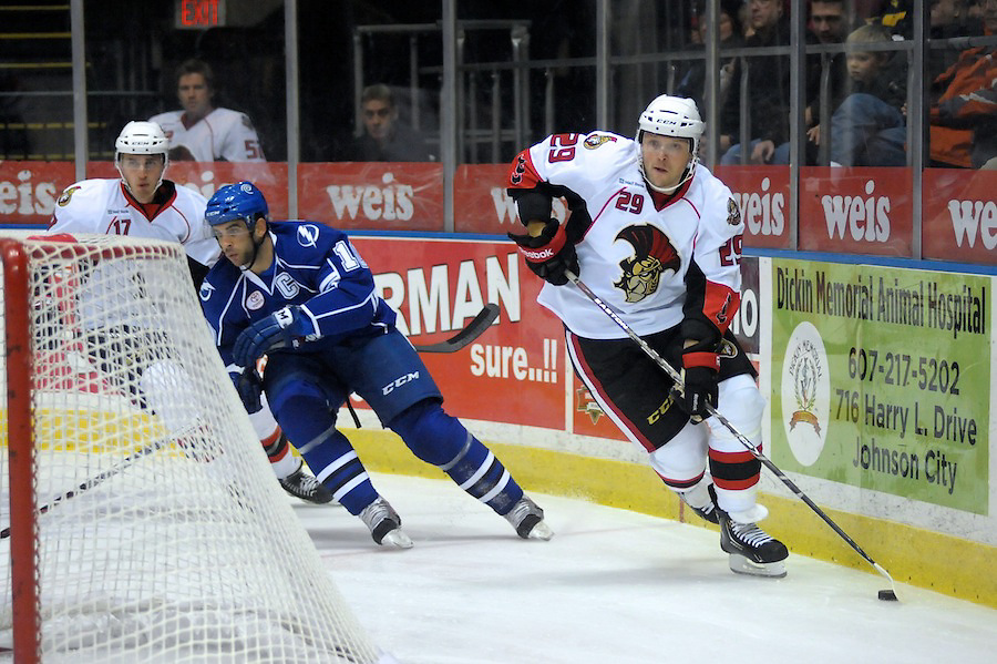 Binghamton Senators defenseman TYLER ECKFORD (29) skates puck from behind the net in the first period against the Syracuse Crunch at the Broome County Veterans Memorial Arena in Binghamton, New York. Binghamton leads Syracuse 2-0 after the first period.